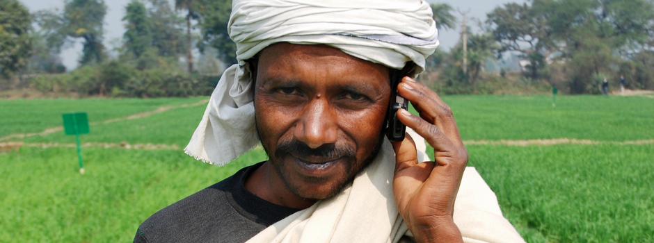 A farmer speaks on his mobile telephone while at work in a wheat field close to the Pusa site of the Borlaug Institute for South Asia (BISA), in the Indian state of Bihar. Poor availability of and access to information can be an important factor in low productivity and slow technology uptake. Information and communication technologies provide new and effective ways to reach farmers with agricultural information. Mobile telephones have become by far the most widespread means of communicating and sharing information in many South Asian and African countries. Mobile phone-based services are a powerful way of enhancing the availability of knowledge and information, leading to greater adoption of new technologies, reduced transaction costs, better market efficiencies, etc., and ultimately improved livelihoods for farmers. BISA is a non-profit research institute dedicated to the improvement of food security and reduction of hunger in South Asia. It is a collaborative effort between the International Maize and Wheat Improvement Center (CIMMYT), The Indian Council for Agricultural Research (ICAR), and the Government of India. BISA's objective is to harness the latest technology in agriculture to improve farming productivity and sustainably meet the demands of the future. More than just a bricks-and-mortar institute, BISA is a commitment to the people of India. It is co-located in three Indian states—Punjab, Bihar, and Madhya Pradesh—each of which contains varied agro-ecological zones, representing many of the environments of South Asia. Farmer information technologies are one of the areas of future development for BISA Pusa. For more on the CIMMYT Agriplex information service for farmers, see: http://blog.cimmyt.org/?p=6101. For more about BISA, see: http://bisa.cimmyt.org/. Photo credit: M. DeFreese/CIMMYT.