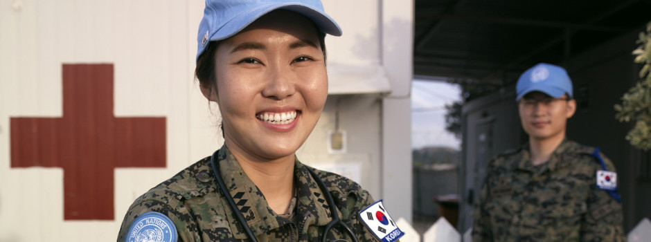 Cpt Eun-Bi Jeong, Nurse Officer, and two of her colleagues photographed next to clinic of the Korean Contingent Headquaters at UN Post 2-5 at the vicinity of Tyre, South Lebanon.